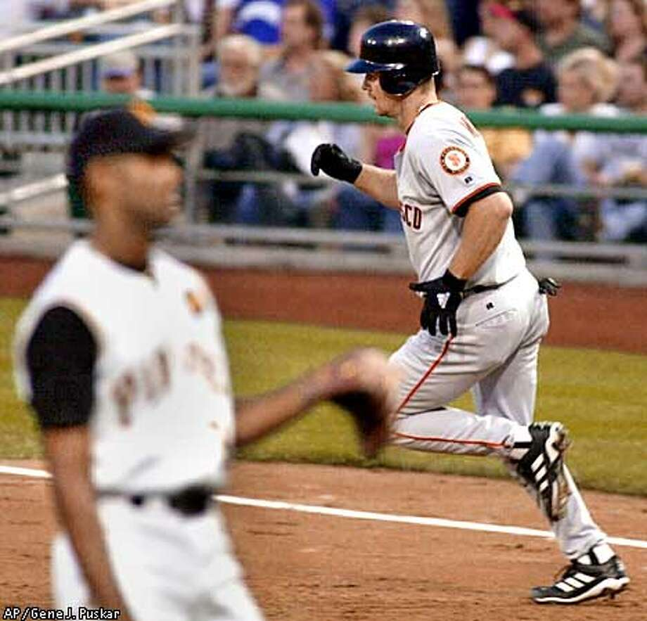 San Francisco Giants' Jeff Kent trots around first base past Pittsburgh Pirates pitcher Ramon Martinez following a three-run homer in the third inning Tuesday May 1, 2001, in Pittsburgh.(AP Photo/Gene J. Puskar) Photo: GENE J. PUSKAR