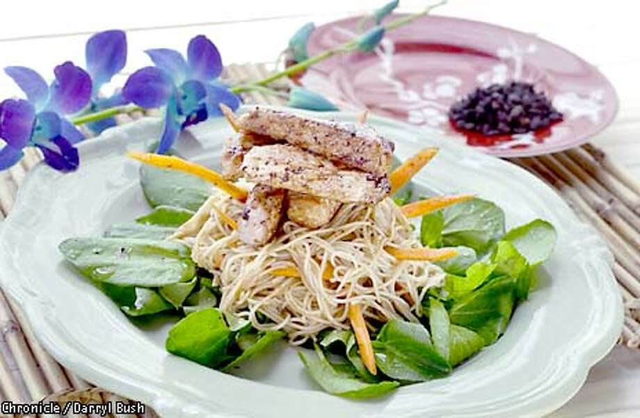 Stir-Fry: Tender strips of pork sit atop delicate rice-stick noodles and watercress. Chronicle photo by Darryl Bush