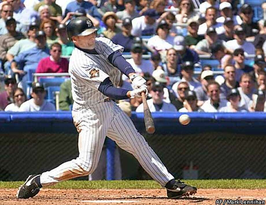 New York Yankees Chuck Knoblauch hits a fourth inning single off Oakland Athletics pitcher Tim Hudson Saturday, April 28, 2001 in New York. Knoblauch scored Alfonso Soriano with the hit and was 4 for 5 in the game. (AP Photo/Mark Lennihan) Photo: MARK LENNIHAN