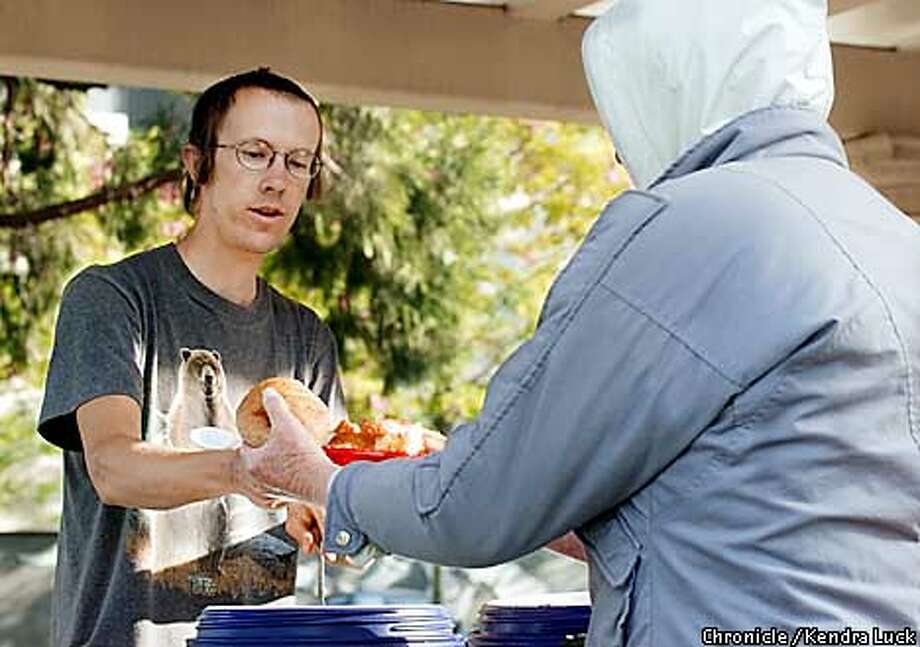 Serving Humanity: Food Not Bombs volunteer Sean Jones of Santa Rosa dishes up vegan soup and bread to whomever asks. Chronicle photo by Kendra Luck