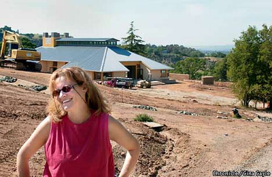 Elaine Taylor of the Taylor Family Foundation stands on the site of an old tuberculosis sanitarium that is being turned into a camp for children with Aids. In the background is the largest building which will be the dining hall/entertainment hall. Photo by Gina Gayle/The SF Chronicle. Photo: GINA GAYLE
