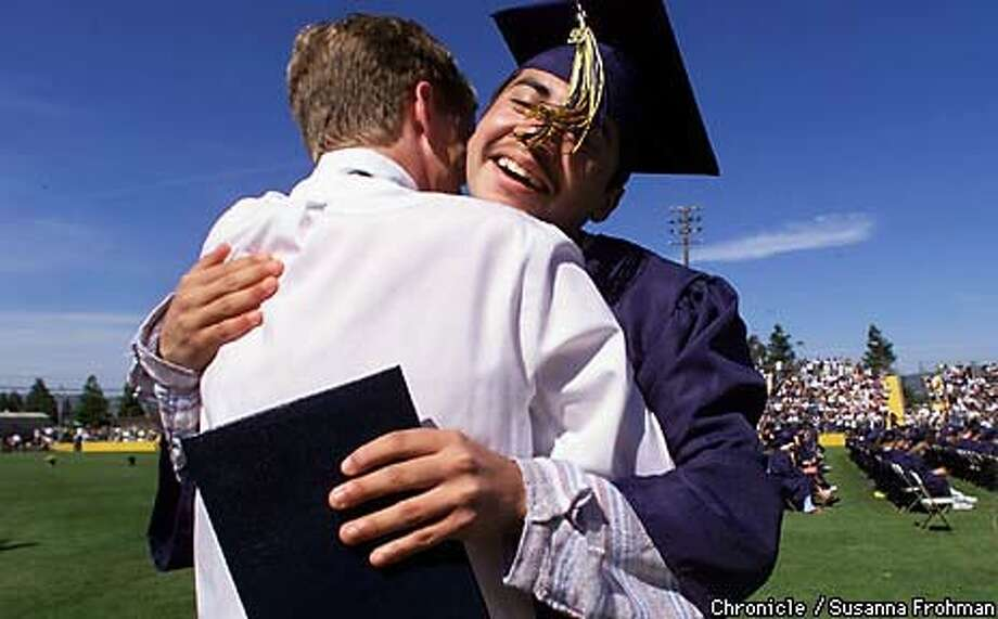 During commencement ceremonies, Luis Trujillo, a senior at Napa High School, got an unexpected hug from science teacher  Rob Kohl. Chronicle Photo by Susanna Frohman