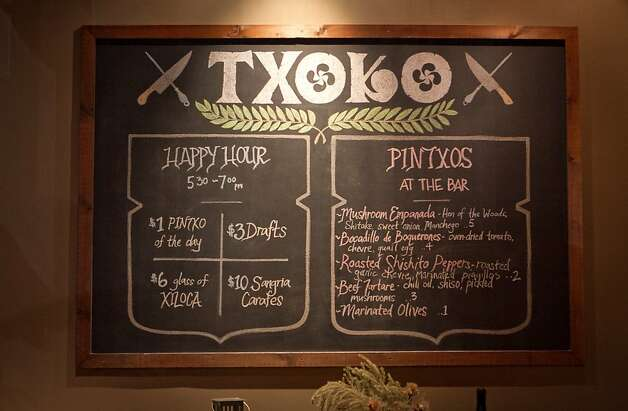 The happy hour menu board at Txoko Restaurant in San Francisco, Calif., is seen on Wednesday, January 25th, 2012. Photo: John Storey