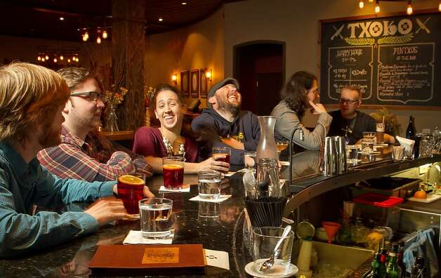 People enjoy happy hour at Txoko Restaurant in San Francisco, Calif., on Wednesday, January 25th, 2012. Photo: John Storey