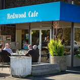 Diners enjoy lunch in the sunshine outside the Redwood Cafe in San Rafael.