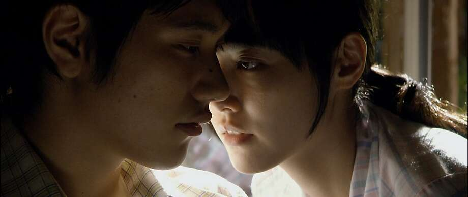 "Naoko (Rinko Kikuchi, right) and Watanabe (Kenichi Matsuyama) are in love in Tran Anh Hung's ""Norwegian Wood,"" a 2010 Japanese film based on the popular Japanese novel by Haruki Murakami. Photo: Soda Pictures"