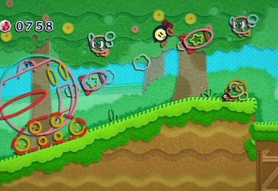 Kirby's Epic Yarn features a character made out of string in a needlepoint world. Photo: Courtesy Nintendo Of America