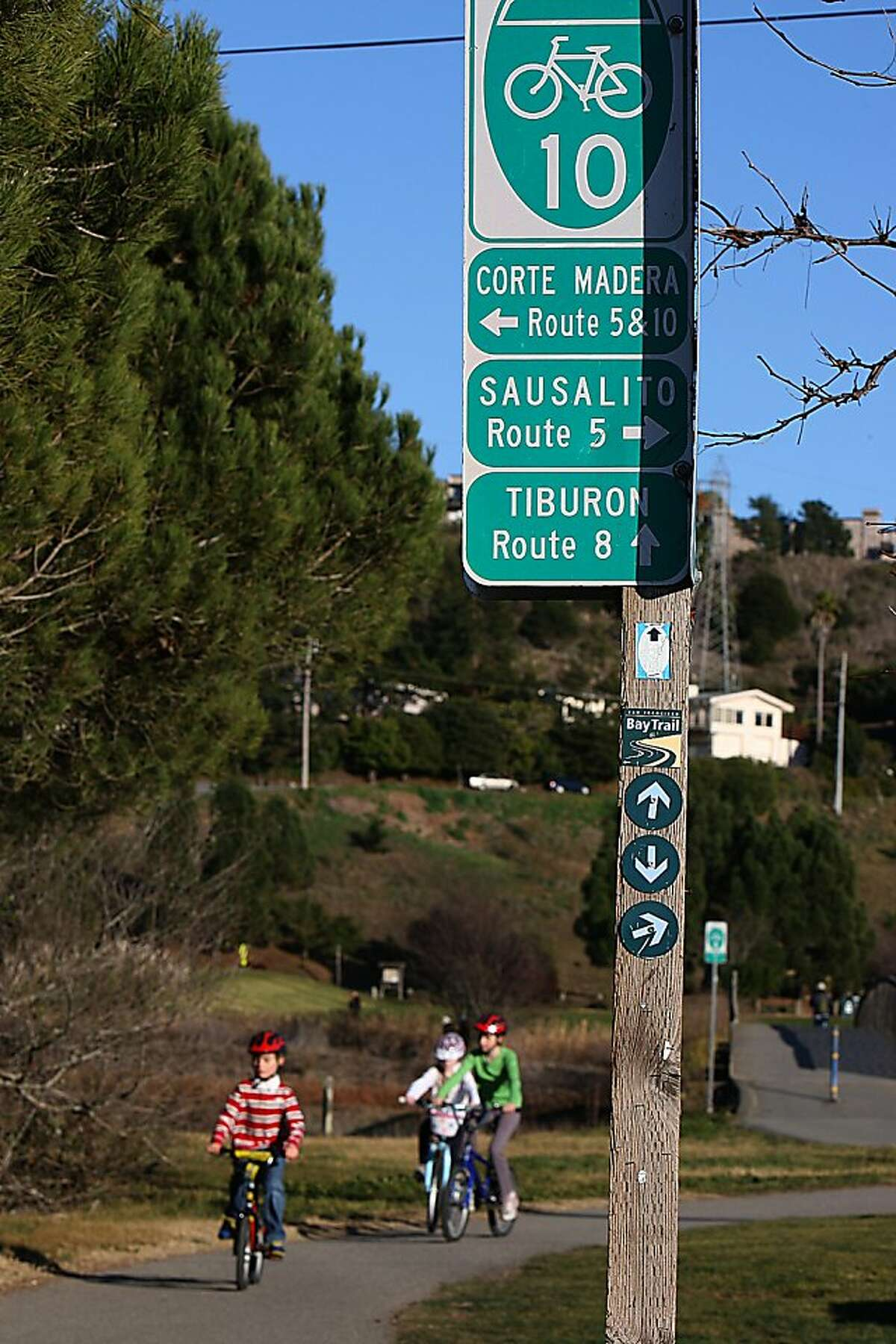 Signage at the Mill Valley-Sausalito path in Mill Valley, Calif., while pedestrians use the path on Sunday, January 15, 2012.