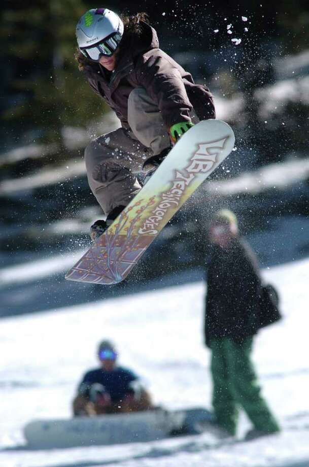 ** FOR IMMEDIATE RELEASE **A snowboarder catches air at  Echo Mountain Terrain Park in Bergen Park, Colo. on Sunday, March 19, 2006. (AP Photo/Bill Ross) Photo: BILL ROSS / AP