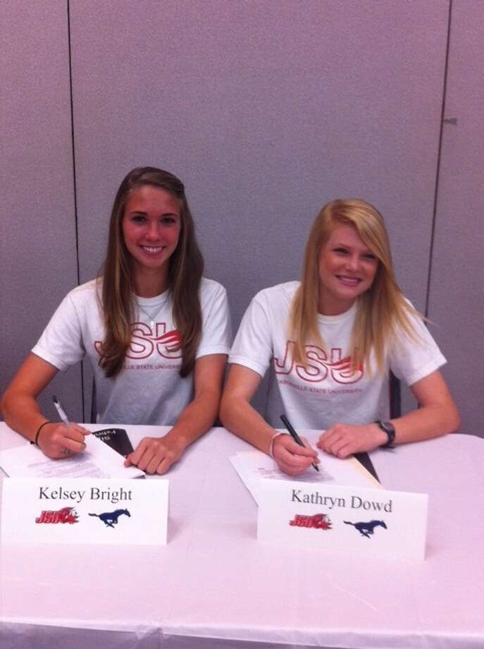 Kingwood High soccer players Kelsey Bright, left, and Katt Dowd sign letters of intent to play for Jacksonville State University. Photo: Handout Photo