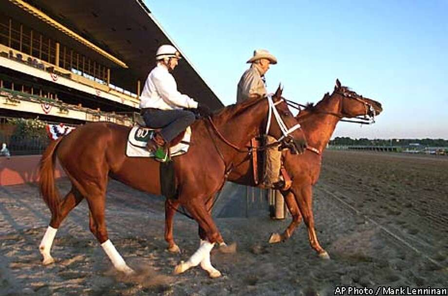 Charismatic, left, with exercise rider Joanne McNamara, walks from the paddock to the track with trainer D. Wayne Lukas at Belmont Park in Elmont, N.Y. Friday, June 4, 1999. Charismatic has a chance to win the Triple Crown on Saturday by winning the . (AP Photo/Mark Lennihan) Photo: MARK LENNIHAN