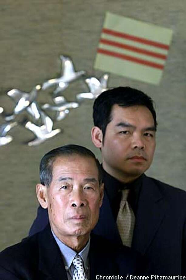 Andrew Lam, right, and his father Thi Quang Lam, at their Milpitas home. Chronicle photo by Deanne Fitzmaurice