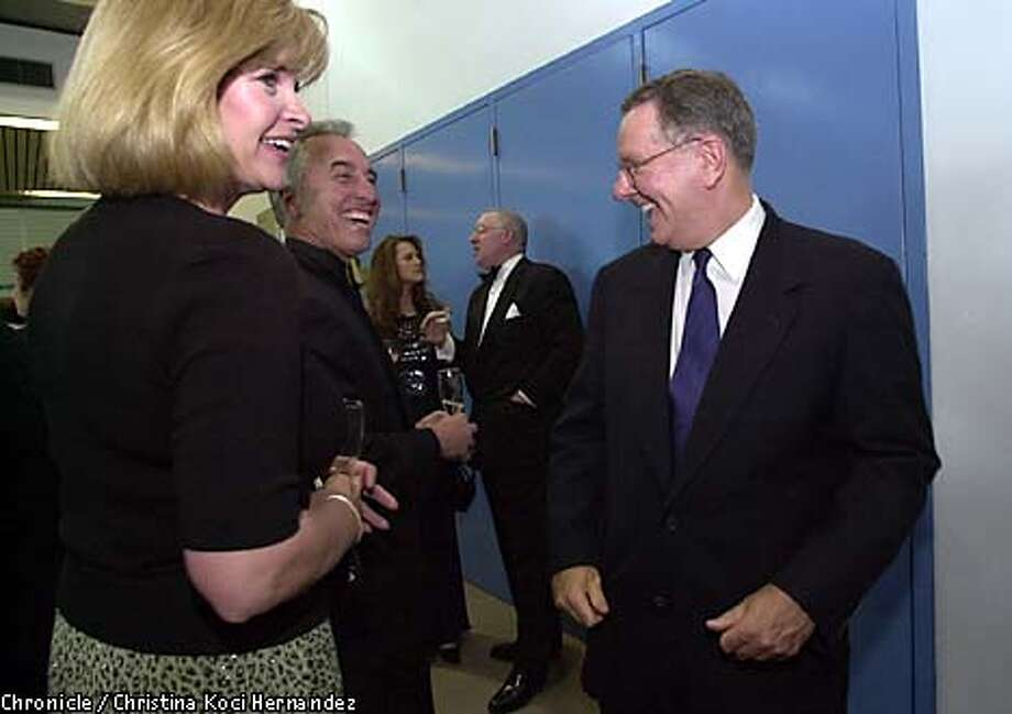 Former presidential candidate Steve Forbes, right, chatted with Paulette and Gerry Beemiller at the party. Chronicle photo by Christina Koci Hernandez