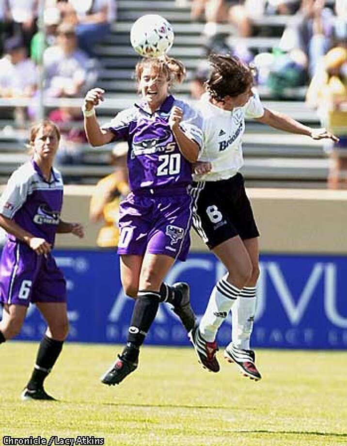 CYBERRAYS2-C-29APR-SP-LA  CyberRays Ann Cook fights Bettina Wiegmann, of the Boston Breakers, for a header in the first half of the game, Sunday Apr.29,01 at Spartan Stadium.  Photo By Lacy Atkins/San Francisco Chronicle Photo: Lacy Atkins