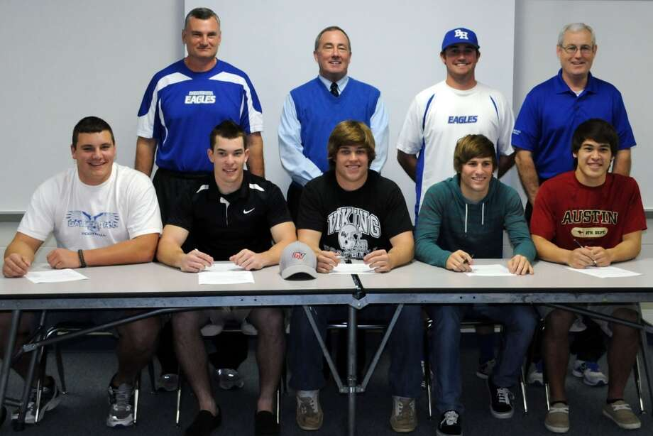 The  football signees from Barbers Hill High School include, front row: Cameron Young, Weber State University signee; Tyler Newcomb, Grand View  University signee; Braden Matthews, Grand View University signee; Richie  Pearson, Grand View University signee; and Andrew McMillan, Austin College  signee. In back are Coach Buddy Griffin, Athletic Director/Head Football Coach Ronnie Gage, Coach  James Gage and Coach Terry Goode.
