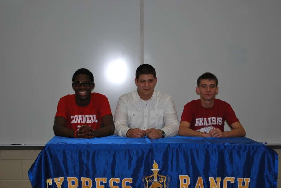 Athletes from Cypress Ranch High  School who signed letters of intent include Stephen Afadapa, left, Cornell University (track); Kyle Rammage, Cisco Junior  College (football); and Cale Wallace, University of  Arkansas (track).