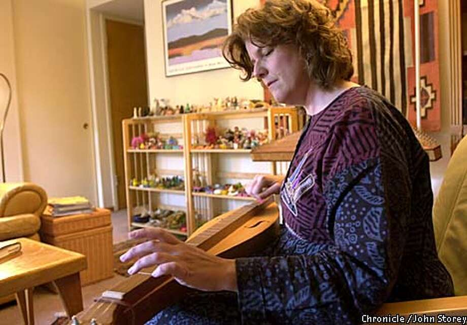Consultant Anne Dilenschneider spends her data sabbath reading and playing the mountain dulcimer. Chronicle photo by John Storey