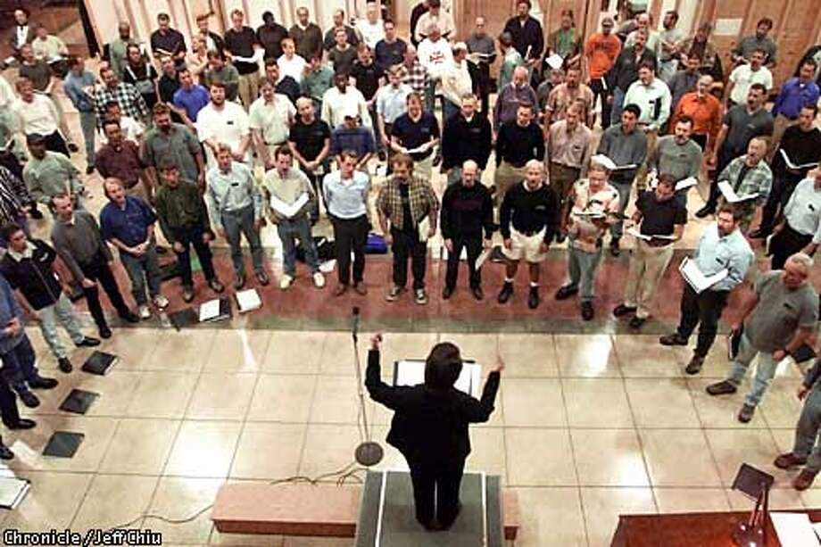 Kathleen McGuire leads the San Francisco Gay Men's Chorus in a rehearsal at Laguna Honda Hospital. Chronicle photo by Jeff Chiu