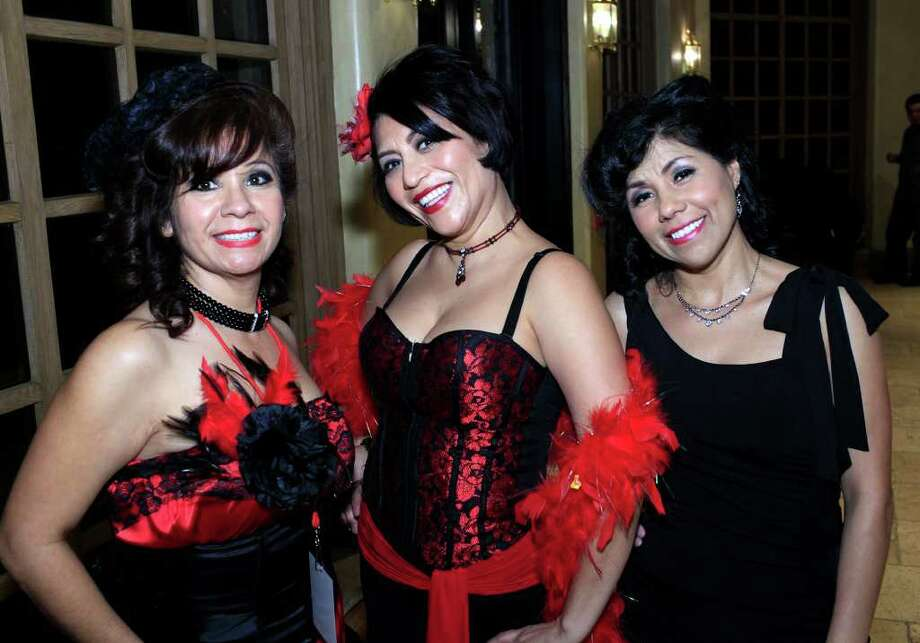 Claudia Cardenas Walton, from the left, Patricia Greenberg and Maria Stockton get together in their best burlesque outfits at the 2nd Annual Women of WOW Burlesque Folies Bergere Event at The Dominion Country Club, Saturday, January 28, 2012. Photo: J. Michael Short , Special To The Express-News / The San Antonio Express-News