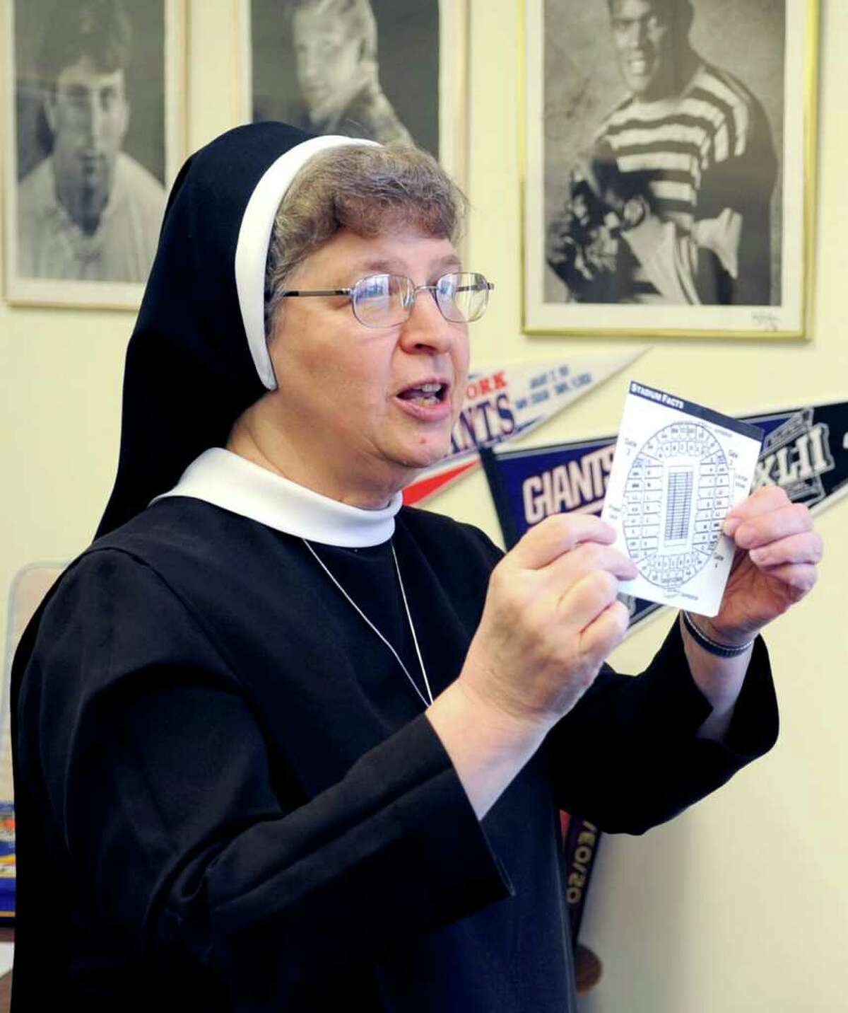 Sister Carol Ann shows photos and memorabilia of the New York Giants, her favorite team, in her office at Villa Maria Education Center in Stamford on Wednesday, February 2, 2012.