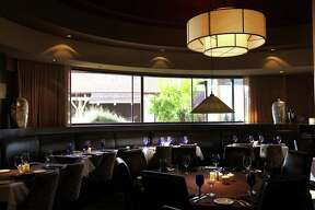 The main dining room at Perry's Steakhouse at the Shops at La Cantera, Friday, January 20, 2012. (JENNIFER WHITNEY)