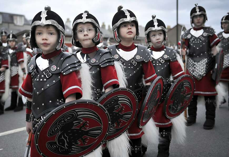 Can we pillage now? PLEEEASE? Young Vikings get ready to sack the city at the annual Up Helly