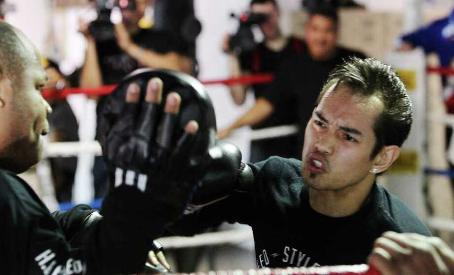 Boxer Nonito Donaire (right) works out at Championfit Gym with sparring partner Morris East on Wednesday, Feb. 1, 2012. Donaire will fight Wilfredo Vazquez, Jr. at the Alamodome on Saturday. Kin Man Hui/San Antonio Express-News Photo: Kin Man Hui, San Antonio Express-News / San Antonio Express-News