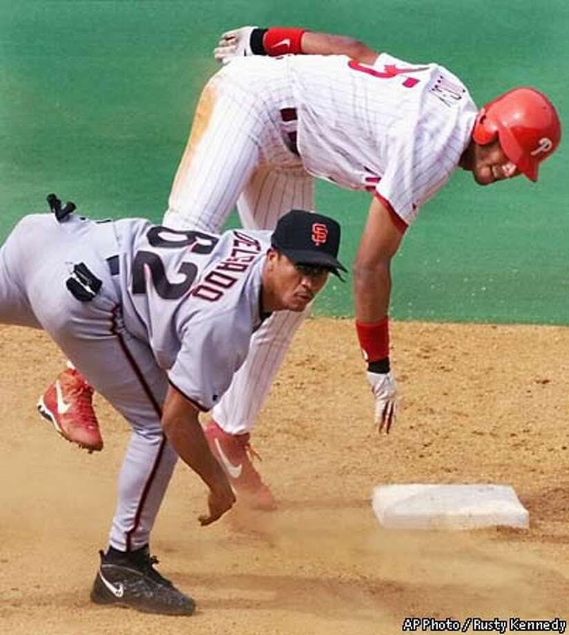 Philadelphia Phillies' Rob Ducey, right, is forced out at second base as San Francisco Giants infielder Wilson Delgado watches his throw complete a game-ending double-play in the ninth inning Thursday, June 3, 1999, in Phildelphia. The Giants won 7-4. (AP Photo/Rusty Kennedy) Photo: RUSTY KENNEDY