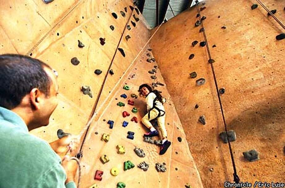 Deepak Puri belays for his daughter Rowan,4, while she climbs at Mission Cliffs Climbing Center in San Francisco.  BY ERIC LUSE/THE CHRONICLE Photo: ERIC LUSE