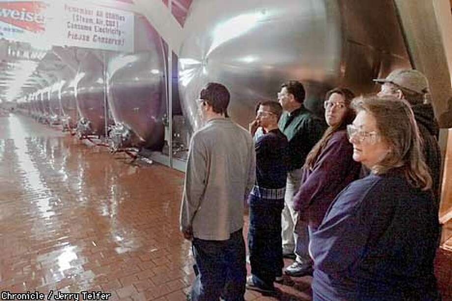 Visitors get a look at Budweiser's lager tanks. Each tank could fill 500,000 12-ounce cans. Chronicle photo by Jerry Telfer