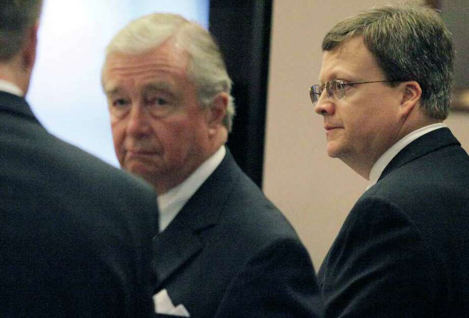 Defendant Jon Thomas Ford, right, waits in court with attorneys Dick DeGuerin, center, and Todd Ward, Wednesday, Feb. 1, 2012, in San Antonio. Ford is accused of murdering ex-girlfriend Dana Clair Edwards following a New Year's Eve party, in the early hours of 2009. Photo: Darren Abate, Darren Abate/Special To The Expr