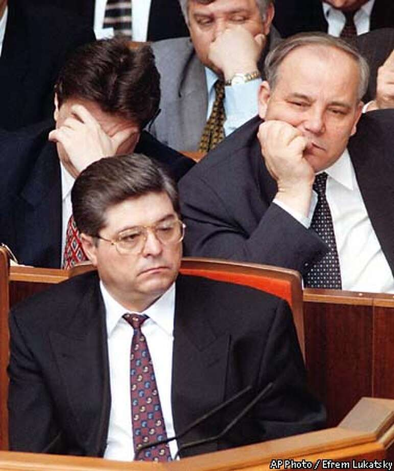 Ukrainian Prime Minister Pavlo Lazarenko, foreground, surrounded by his colleagues, sits during a Parliament session in Kiev, early June 1997. President Leonid Kuchma replaced Pavlo Lazarenko on Thursday, June 19, for the duration of an unspecified illness, in a move an administration official indicated could lead to his dismissal. (AP Photo/Efrem Lukatsky) Photo: EFREM LUKATSKY