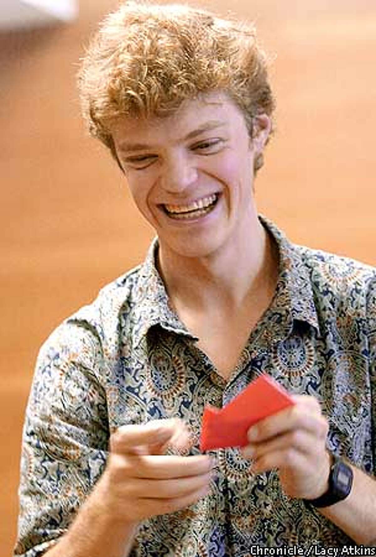 Jeremy Shafer laughs as he makes an origami broken heart at the Bay Area Rapid Folders meeting. Chronicle photo by Lacy Atkins