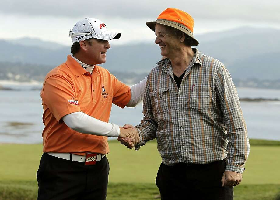 Tournament champion D.A. Points and amateur champion Bill Murray celebrate their victories after the final round of the AT&T Pebble Beach National Pro-Am on Sunday. Photo: Michael Macor, The Chronicle