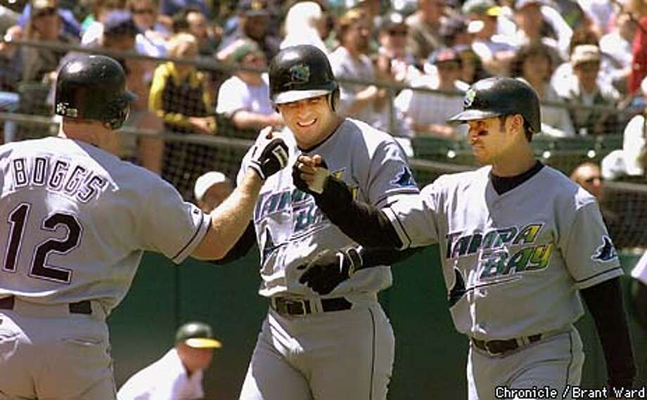 A'S-CANSECO/02JUN99/SP/BW--Jose Canseco, center, is congratulated after 3-run homer in 5th. Also coming home was Dave Martinez, right, who was congratulated by Wade Boggs. By Brant Ward/Chroniicle Photo: BRANT WARD