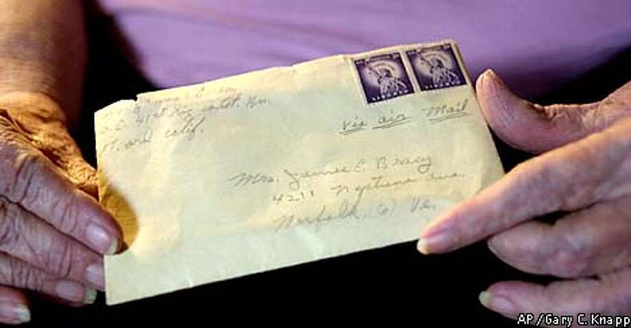 Sallie Bracy held a letter mailed by her husband 46 years ago from Fort Ord in Monterey. She received it last month. Associated Press photo by Gary C. Knapp