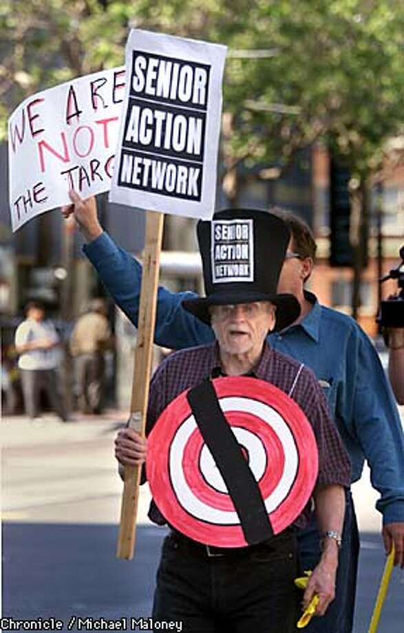 Delbert Scott of the Senior Action Network wore a target as he protested reckless driving at Van Ness Avenue and Market Street. Chronicle photo by Michael Maloney