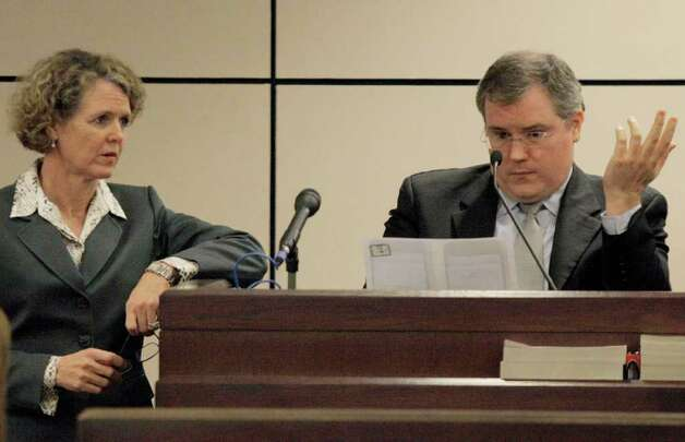 Prosecutor Catherine Babbitt (left) speaks with witness Alan Tarver on the opening day of the Jon Thomas Ford trial, Wednesday, Feb. 1, 2012, in San Antonio. Ford is accused of murdering ex-girlfriend Dana Clair Edwards following a New Year's Eve party, in the early hours of 2009. Photo: Darren Abate, For The Express-News