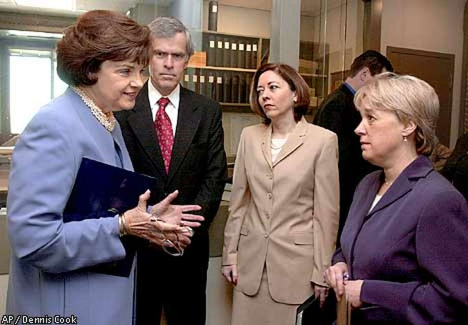 Sens. Dianne Feinstein (left), Jeff Bingaman, D-N.M., Maria Cantwell, D-Wash., and Patty Murray, D-Wash., met before a news conference. Associated Press photo by Dennis Cook