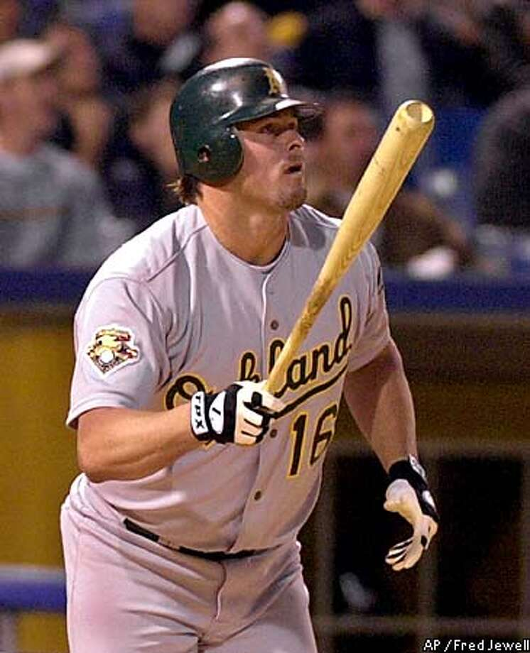 Oakland's Jason Giambi made Chicago starter Mark Buehrle pay for a pair of hit batsmen and a walk with his third-inning grand slam. Associated Press photo by Fred Jewell