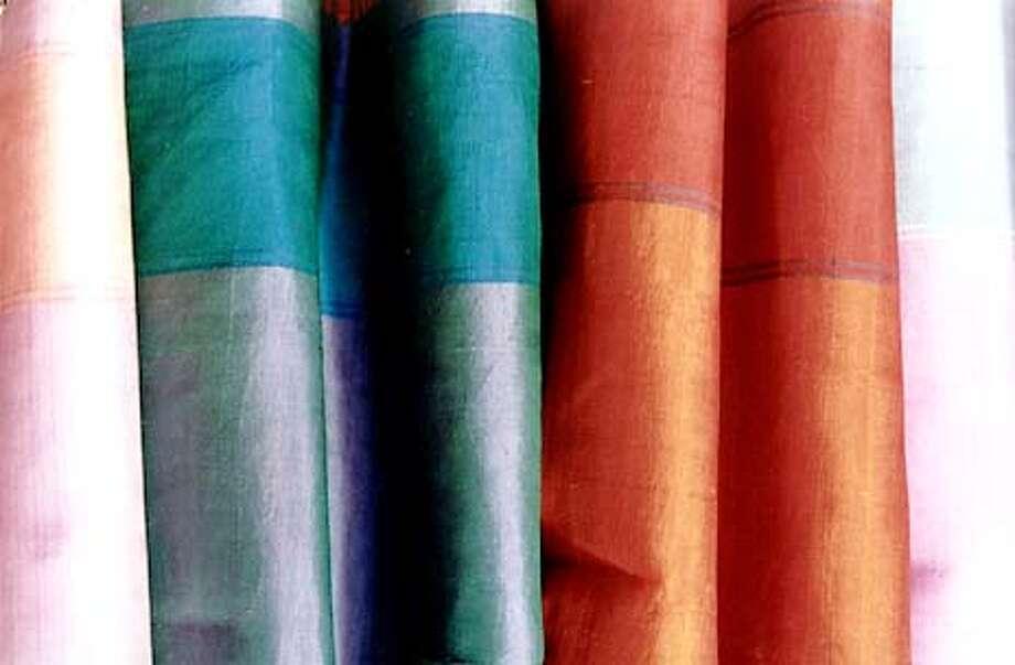 Silk scarves and shawls from Thailand. Photo courtesy of Suma
