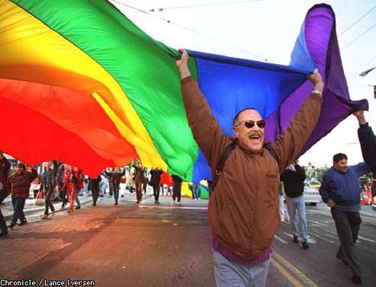 GAY RIGHTS/20MAY96/MN/LI Allen Charlton from San Francisco marches down Castro street in celebration after the supreme Court ruled in favor of the gay community in Colorado banning laws that discriminate against gays. By Lance Iversen/SF Chronicle