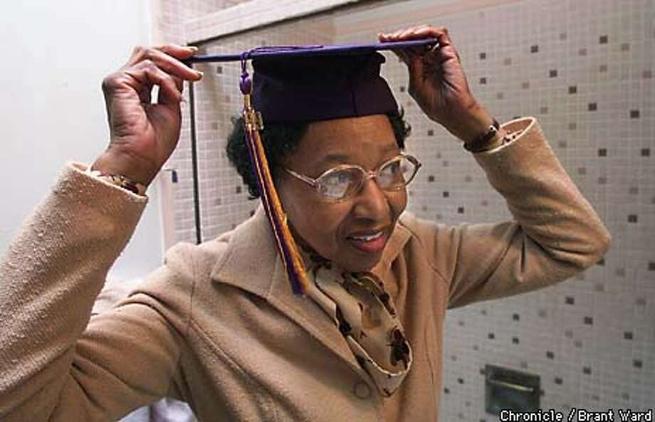 GRAD1/27MAY99/MN/BW--76 year old student Josie Fisher tries on her graduation cap at her San Francisco home. She'll get her degree in photography on Saturday from SF State. By Brant Ward/Chronicle Photo: BRANT WARD
