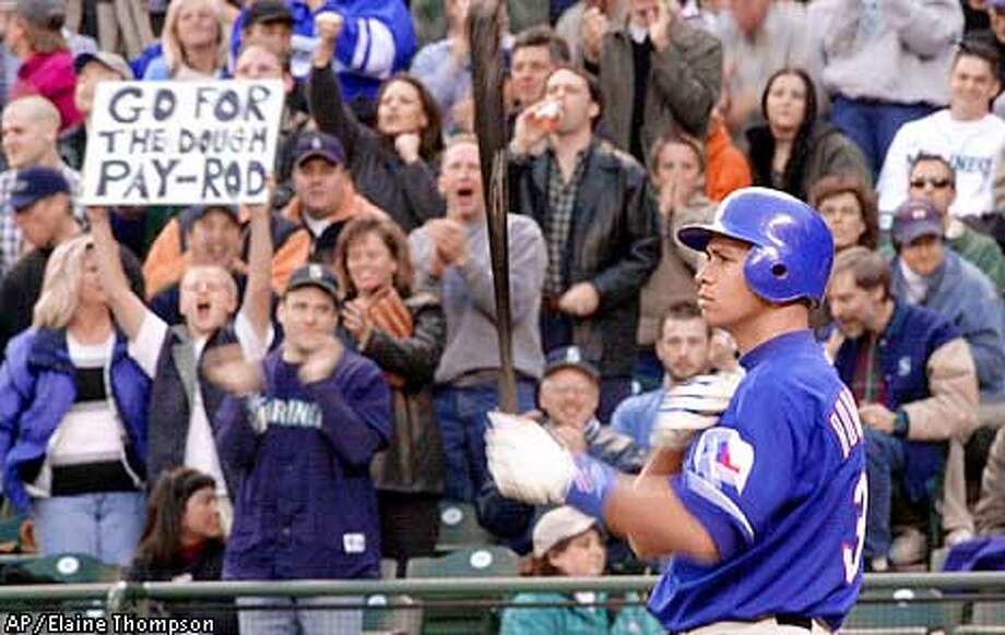Texas Rangers' Alex Rodriguez is cheered and jeered by Seattle Mariners fans as he steps to the plate in the first inning Monday, April 16, 2001, in Seattle. The appearance in Seattle is Rodriguez's first since leaving the Mariners to sign with the Rangers. (AP Photo/Elaine Thompson) Photo: ELAINE THOMPSON