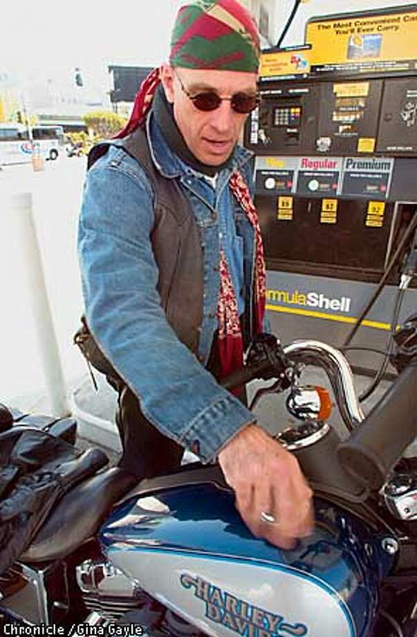 Mike Burck fills up his motocycle for only $5.61 at the Shell station on the corner of 6th and Harrison. Regular was $2.09, pplus was $2.19 and Premium was $2.29. Photo by Gina Gayle/The SF Chronicle. Photo: GINA GAYLE