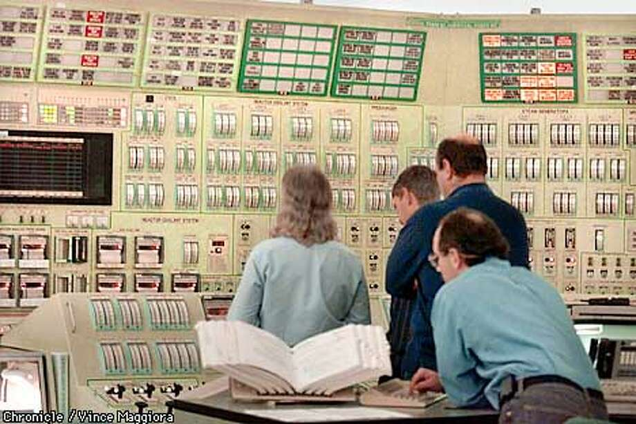 Control room workers looking at the reactor coolant system.Fuel rods are now being changed at PG&E's Diablo Canyon nuclear power plant. storage space for spent fuel rods that will be depleted within a few years, and it is unknown where the plant will dispose of its nuclear waste in the future. Meanwhile, PG&E is profiting handsomely from a surge in wholesale electricity prices, making Diablo Canyon, which was once criticized as an inefficient white elephant, a cash cow for the utility. by Vince Maggiora. Also ran 11/8/2000. Photo: VINCE MAGGIORA