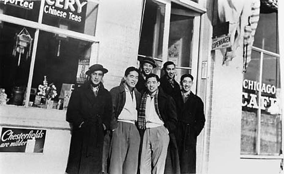 """1939--Chinese pro basketball team called the Hong Wah Kues at the start of their 1939-40 tour. Left to right--Robert Lum, Fred Wong, , Fred Gok (top), Chauncy Yip (scarf), George Lee (top, right), and Albert """"Sunny"""" Lee (far right). copied photo from an exhibit at the Chinese Cultural Center Photo: LIZ HAFALIA"""