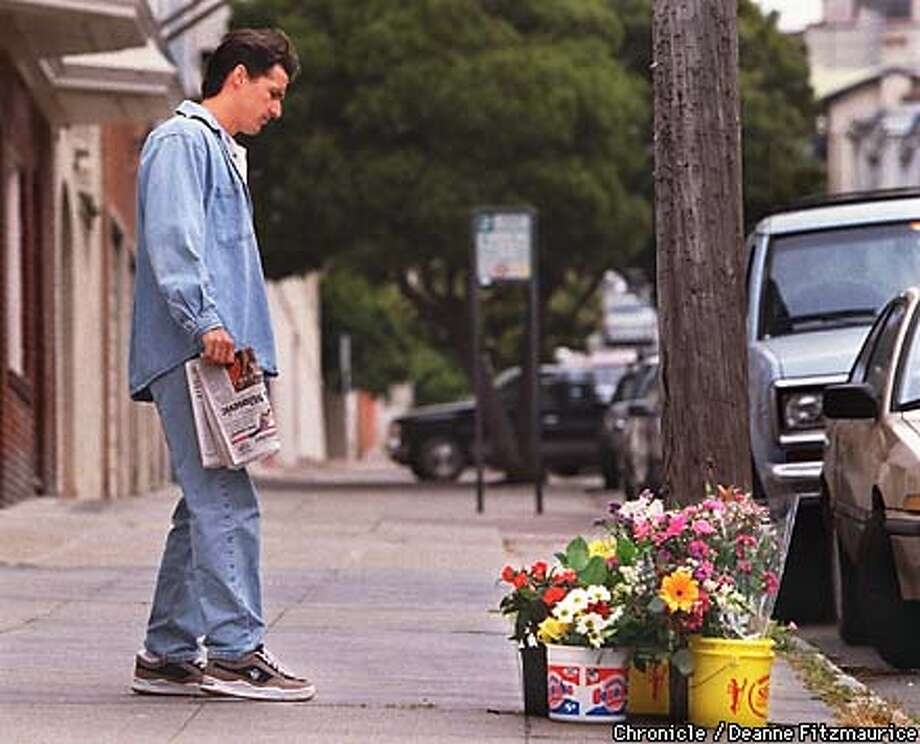 A neighbor pauses to look at an impromptu memorial for slain tourist, Shayne Worcester, on Vallejo St. at Hyde St. CHRONICLE PHOTO BY DEANNE FITZMAURICE Photo: DEANNE FITZMAURICE
