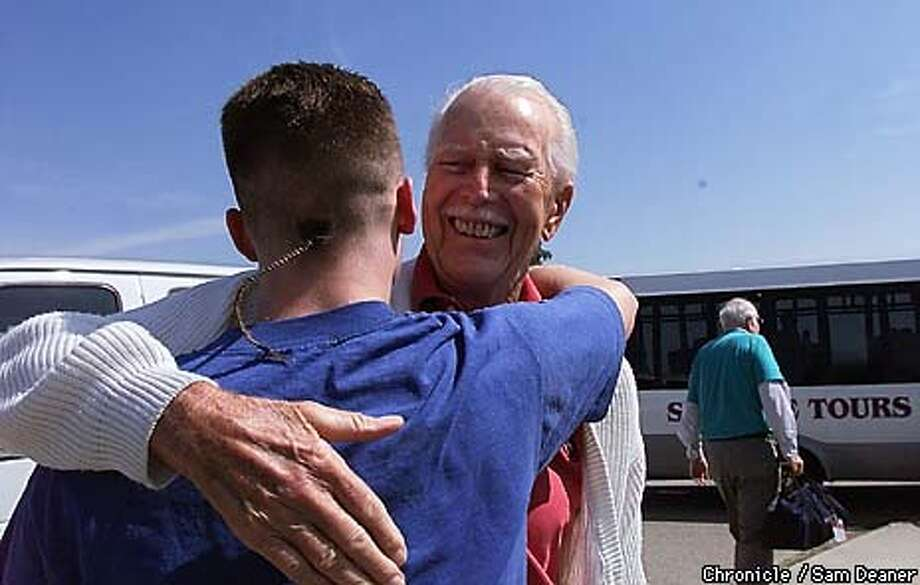 Rossmore resident Ray Alberts, 85, embraces Steven-- a 17-year-old juvenile at the Byron's Boys Ranch. Ray and Steven developed a relationship during Steven's time at the ranch meeting every week in the Rossmore tutor program. The teenager's hug for Ray was special because the teenager was going home the next day after 9-months in the rehabilitaion program. CHRONICLE PHOTO SAM DEANER Photo: SAM DEANER