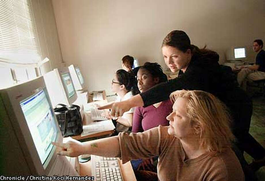 DIVIDE23a-C-20APR01-B-CH  CHRISTINA KOCI HERNANDEZ/CHRONICLE  Here, graduates of a 16 week training course at Bay Area Video Coalition in San Francisco, put the finishing touches on their web page design projects. (R to L) Melissie Feigum (cq), (standing)Mary Anderson, Binta Jeffers, and (glasses)Lani Tanaka.Students at Bay Area Video Coalition work on portfolios, hoping to land jobs in the highly competitive technology industry. Photo: CHRISTINA KOCI HERNANDEZ